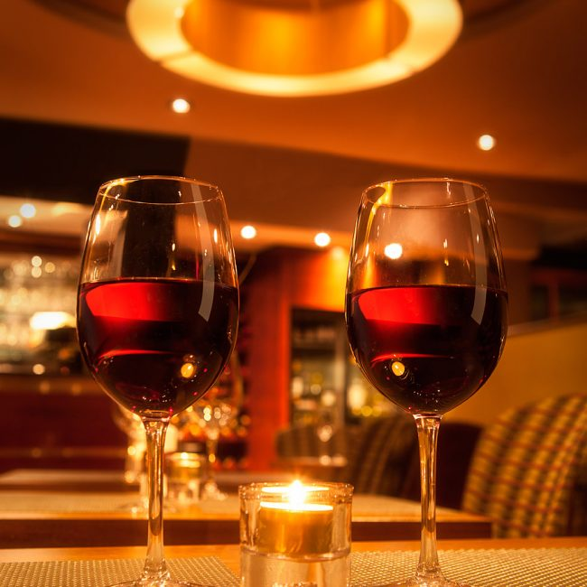 Two Wine Glasses on a Restaurant Table Photograph by Norton Photography and Retouching