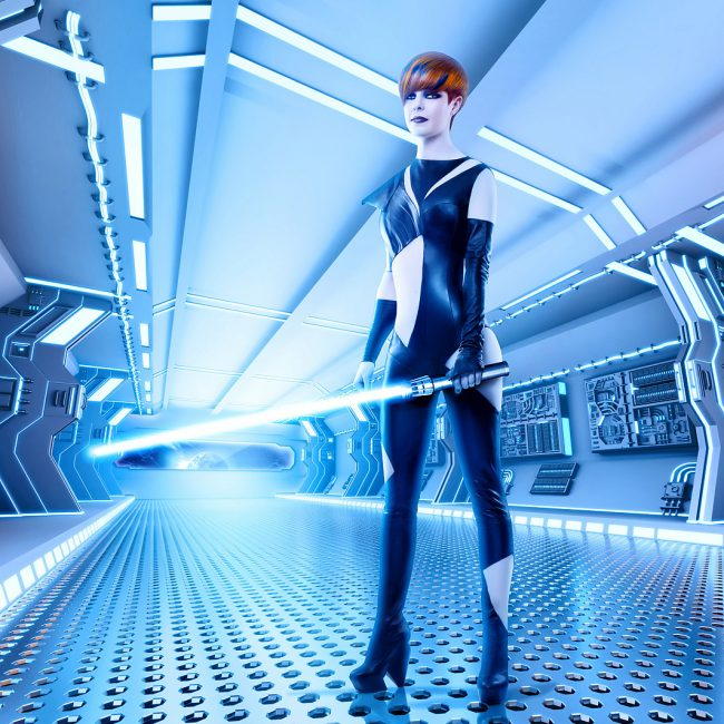 Woman Standing Holding Blue Lightsaber on Spaceship Portrait by Norton Photography and Retouching
