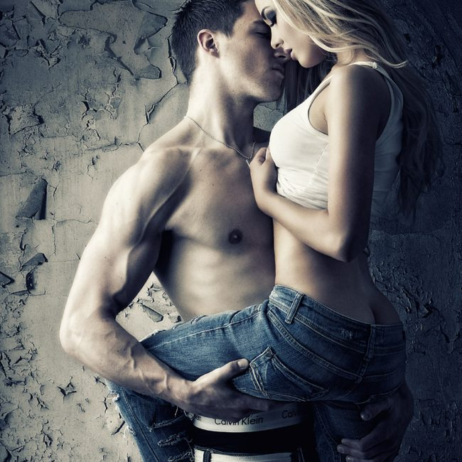 Steamy Photograph of a Young Couple in Denim Jeans and Calvin Klein Boxes Clothing Advertising