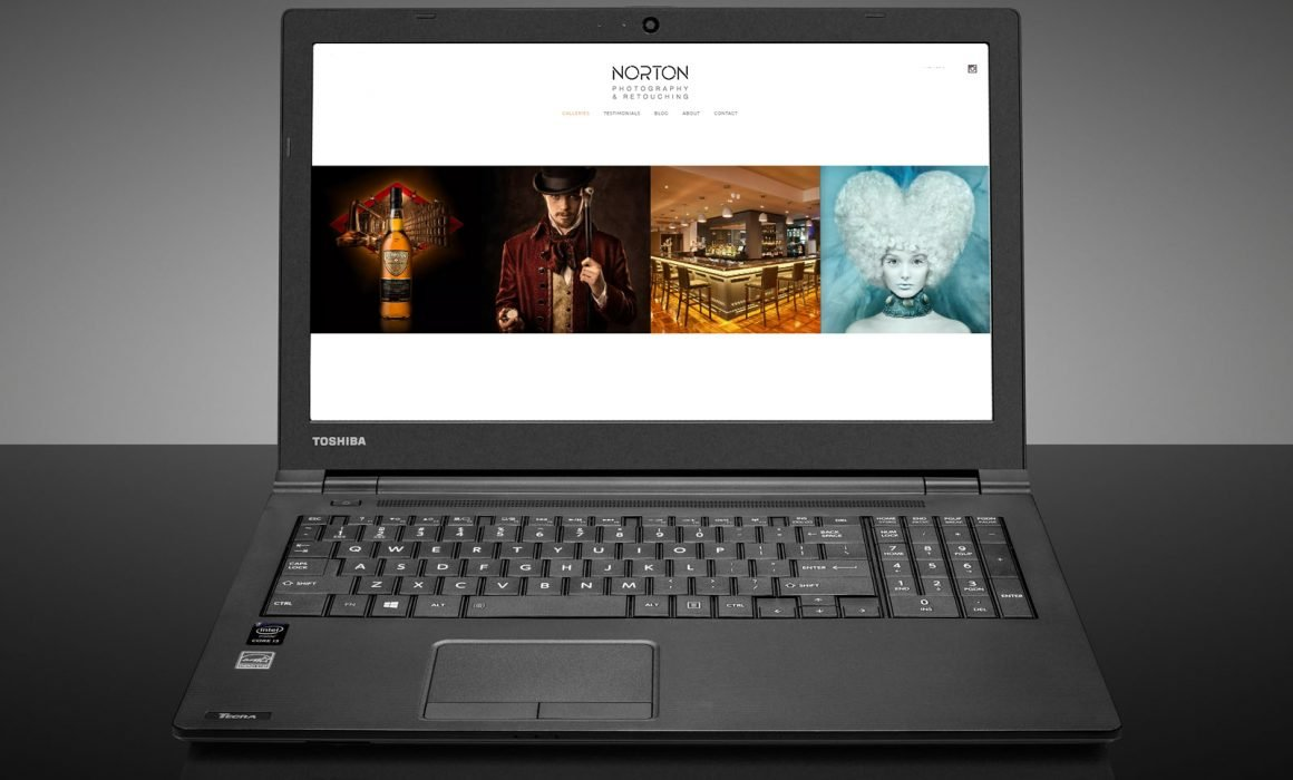 Toshiba Laptop with the new Norton Photography and Retouching website loaded on screen